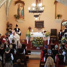 Cuerres se pone bajo cubierta para celebrar un San Antón pasado por agua